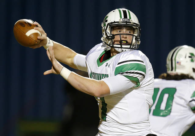 Jacob Lewis of Bishop McGuinness drops back to pass against Guthrie during their high school football game in Guthrie, Okla., Friday, November 1, 2013. Photo by Bryan Terry, The Oklahoman