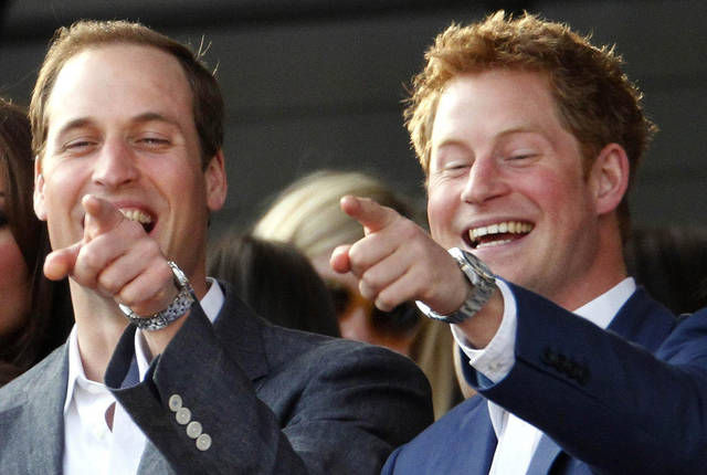 The Duke of Cambridge with his brother Prince Harry, right, pointing at something as they attend the Diamond Jubilee concert in London Monday June 4, 2012. Thousands of flag-waving fans gathered to watch British music royalty celebrate Queen Elizabeth II on Monday with a Buckingham Palace concert featuring acts from throughout her 60-year-reign. But the queen's husband, Prince Philip, missed the concert after being hospitalized with a bladder infection. (AP Photo / Dave Thompson, Pool)