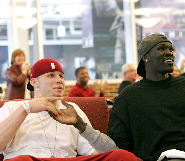 Blake Griffin (left) and Longar Longar react to the Sooners' spot in the NCAA tournament as they watch the NCAA selection Sunday on television at the Lloyd Noble Center in Norman, on March 13, 2008. By John Clanton, The Oklahoman ORG XMIT: KOD