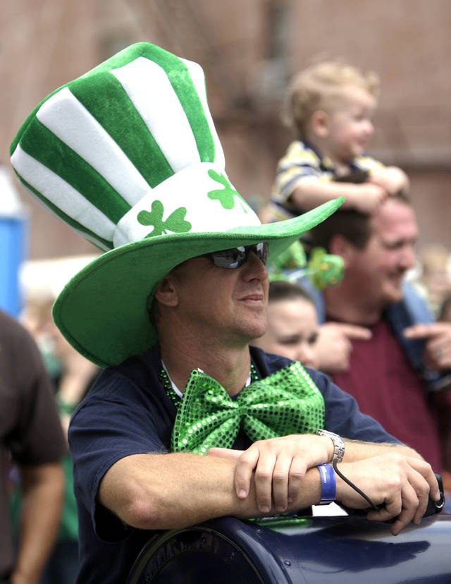 Brian Arnold of Oklahoma City watches the St. Patrick's Day Parade in Oklahoma City, Saturday, March 17, 2012. Photo by Sarah Phipps, The Oklahoman.