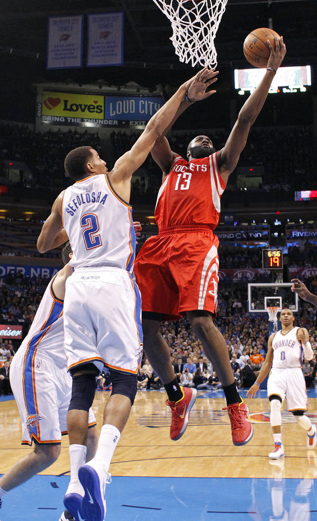 Oklahoma City 's Thabo Sefolosha (2) defends on a shot by Houston's James Harden (13) during the NBA basketball game between the Houston Rockets and the Oklahoma City Thunder at the Chesapeake Energy Arena on Wednesday, Nov. 28, 2012, in Oklahoma City, Okla.   Photo by Chris Landsberger, The Oklahoman