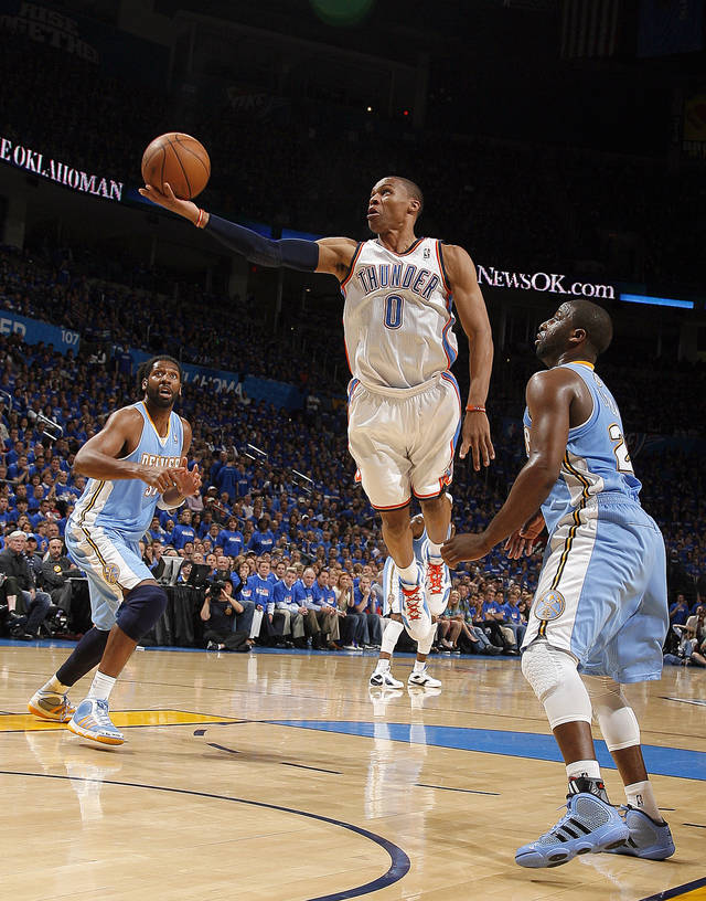 Oklahoma City's Russell Westbrook (0) shoots a lay up in front of Denver's Raymond Felton (20) during the first round NBA basketball playoff game between the Oklahoma City Thunder and the Denver Nuggets on Wednesday, April 20, 2011, at the Oklahoma City Arena. Photo by Sarah Phipps, The Oklahoman