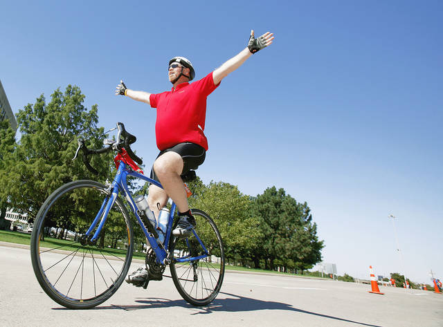 Kevin Mather of Bixby celebrates Sunday as he nears the finish of the 24th Annual Bike MS: The Mother Road Ride at the state Capitol. PHOTO BY SARAH PHIPPS,  THE OKLAHOMAN