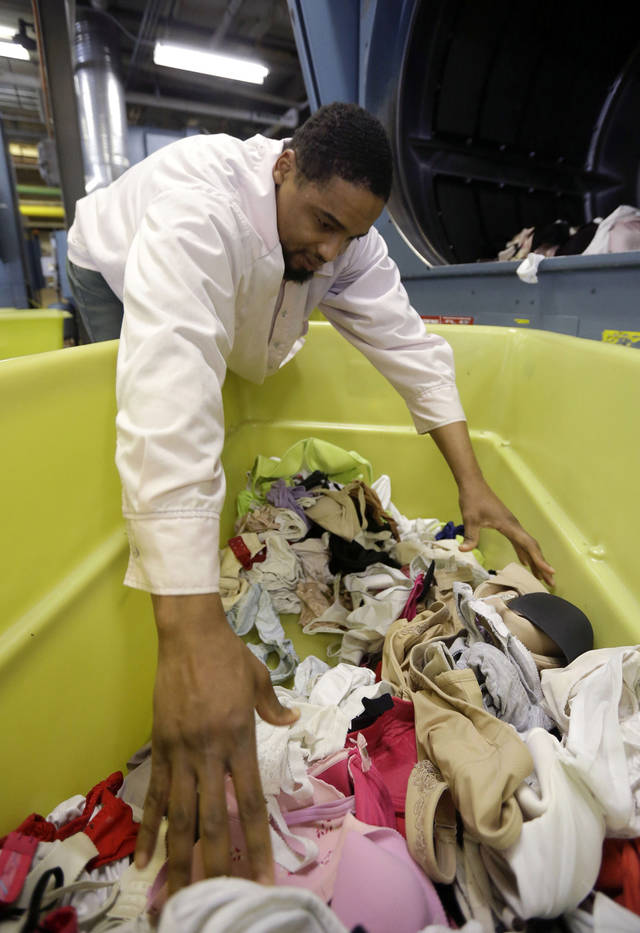 Inmate Alfonso Young loads bras that are being laundered as part of a breast cancer awareness campaign into a dryer at Central Maryland Correctional Facility in Sykesville, Md., Thursday, Dec.  13, 2012. Nearly 10,000 bras were expected to be laundered by the inmates after they were collected by a radio station in Frederick, Md. One dollar for each bra was donated to breast cancer research, and the cleaned bras are expected to be donated to women's shelters. Inmates at the facility annually handle more than 2.2 million pounds of laundry from state agencies and non-profit organizations in Maryland. (AP Photo/Patrick Semansky)
