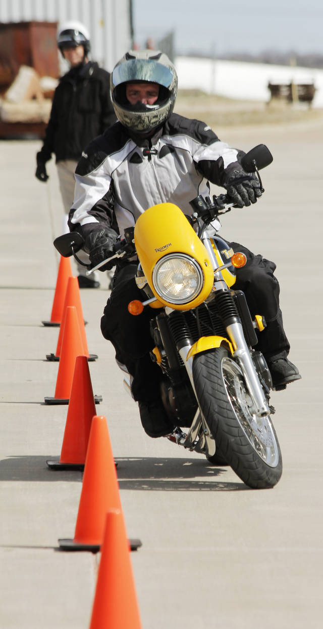 Clint Drabek drives his motorcycle through cones at the civilian motorcycle training course at the Edmond fire department training grounds Saturday, March 3, 2012. Photo by Doug Hoke, The Oklahoman