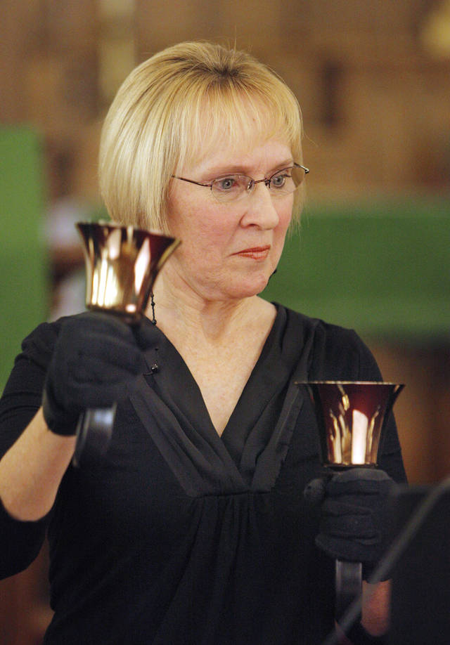 Trish DeCastro, from Okla. City, playing the handbells during a rehearsal of the Canticle Ringers of St Paul's Lutheran Church in the sanctuary at First Lutheran Church in Oklahoma City Tuesday, Feb. 7, 2012. The Canticle Ringers are rehearsing for the First Tuesday Concert Series featuring area musicians. The next concert is at noon, March 6, featuring musician Scott Chard at First Lutheran Church. Photo by Paul B. Southerland, The Oklahoman