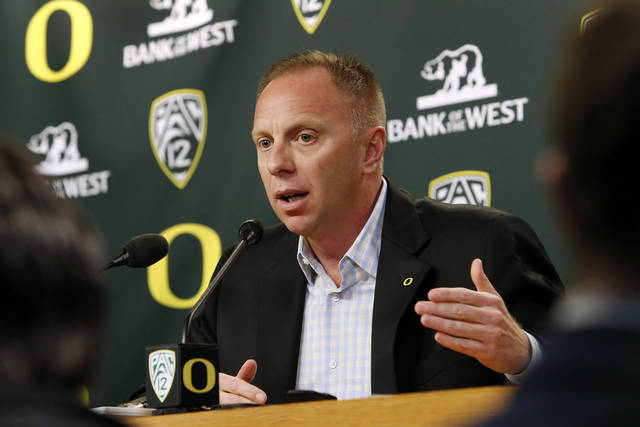 Oregon athletics director Rob Mullens speaks about the departure of head football coach Chip Kelly and the school's resulting hiring search during an NCAA college news conference, Wednesday, Jan. 16, 2013, at the Casanova Center in Eugene, Ore. After dramatically opting to stay with the No. 2 Ducks a little more than a week ago, the enigmatic Kelly changed his mind and decided to take an NFL job as head coach of the Philadelphia Eagles. (AP Photo/The Register-Guard, Brian Davies)