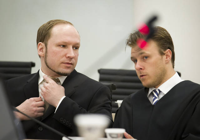 Confessed mass-murderer Anders Behring Breivik talks with his Tord Jordet, one of Breivik's lawyers inside court as the trial against him continues in Oslo, Norway, Tuesday May, 29, 2012. Three former friends of Breivik gave evidence Tuesday about his deep depression, living with his mother and his lack of social contacts while Breivik watched from an adjoining room. The terror trial continues against the anti-Muslim fanatic, Breivik, who has confessed to killing 77 people in July 2011, when he 8 people by setting off a bomb in central Oslo, and then shot to death 69 people on Utoya island, outside the Norwegian capital. (AP Photo / Heiko Junge, NTB scanpix) NORWAY OUT