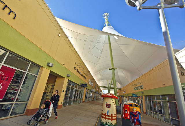 Shoppers walk inside the The Outlet Shoppes at Oklahoma City, at 7624 W Reno Avenue, on Tuesday, Jan. 3, 2012, in Oklahoma City, Okla. The new outlet mall has been a consistent boost to OKC's sales tax revenue. Photo by Chris Landsberger, The Oklahoman