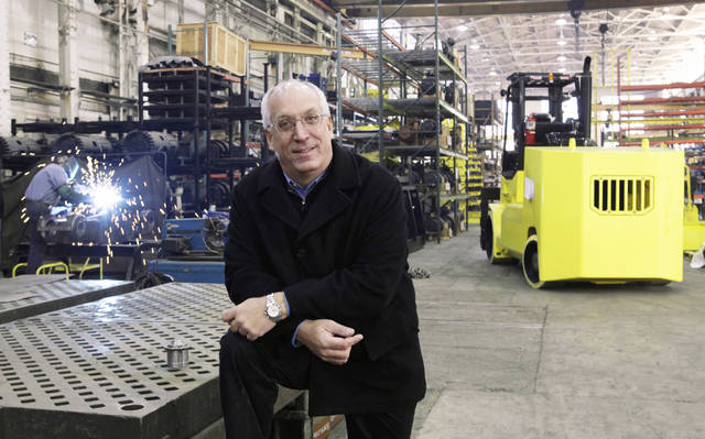 Marty Flaska, owner of Hoist Liftruck in Bedford Park, Ill., poses inside his facility Thursday. After sales plummeted over the summer, Flaska had to lay off all but 79 employees out of a staff of 330.  AP Photo