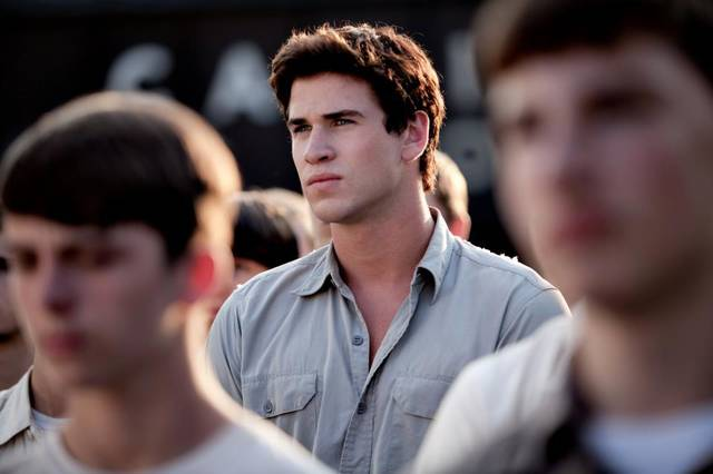 Gale Hawthorne (Liam Hemsworth), Katniss' best friend and hunting partner, waits for the reaping to begin.