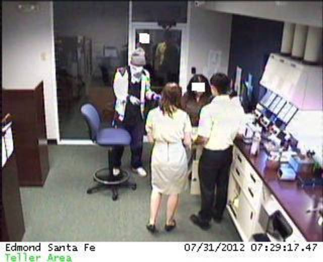 This image from a security camera shows a teller line at IBC Bank, 421 S Santa Fe in Edmond. PHOTO PROVIDED