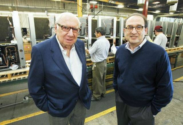 Jack Golsen, CEO (left) and Barry Golsen, Chairman of LSB Industries, stand in front of one of the assembly lines at ClimateMaster in Oklahoma City, OK, Monday, Oct. 17, 2011. By Paul Hellstern, The Oklahoman ORG XMIT: KOD