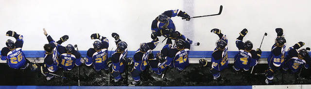 St. Louis Blues left wing David Perron celebrates with teammates after scoring against the San Jose Sharks during the third period in Game 5 of an NHL Stanley Cup first-round hockey playoff series, Saturday, April 21, 2012, in St. Louis. The Blues won 3-1 and won the series 4-1. (AP Photo/St. Louis Post-Dispatch, Chris Lee) EDWARDSVILLE INTELLIGENCER OUT; THE ALTON TELEGRAPH OUT