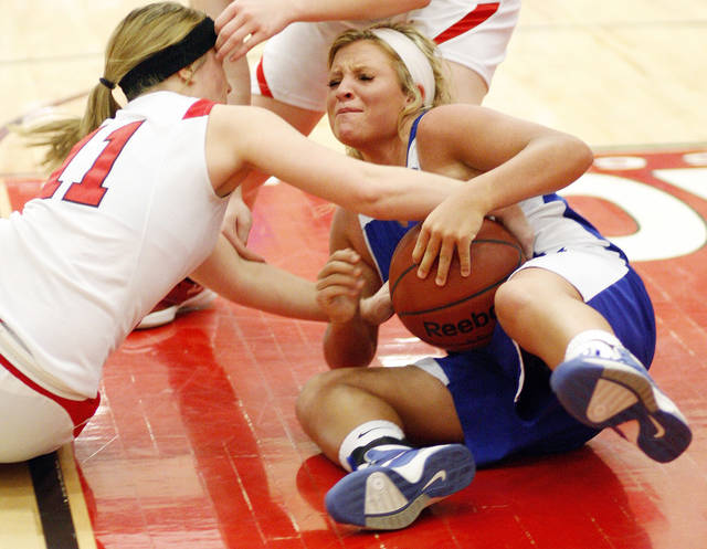Erick's Maranda Janz (11), left, and Hammon's Lexie Brown (20) battle for a loose ball during a Class B girls high school basketball area playoff game between Erick and Hammon at Yukon High School in Yukon,  Okla., Friday, Feb. 24, 2012. Photo by Nate Billings, The Oklahoman
