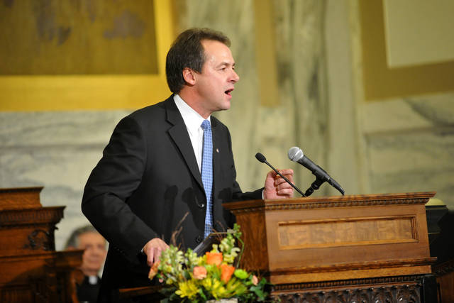 "Gov. Steve Bullock talks about tax laws in his State of the State address Wednesday evening Jan. 30, 2013 in the House Chambers. Bullock promised on Wednesday to ""change the tone"" in the Capitol as he asked a Legislature led by opposition Republicans to help him in cutting taxes, fixing the state pension system, increasing education funding, expanding Medicaid and shedding light on the so-called ""dark money"" flooding politics. (AP Photo/The Independent Record, Dylan Brown)"