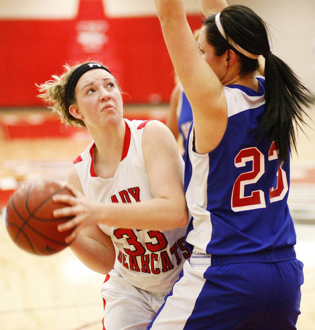 Erick's Hannah Millar (33) tries to score past Hammon's Peyton Walker (23) during a Class B girls high school basketball area playoff game between Erick and Hammon at Yukon High School in Yukon,  Okla., Friday, Feb. 24, 2012. Photo by Nate Billings, The Oklahoman