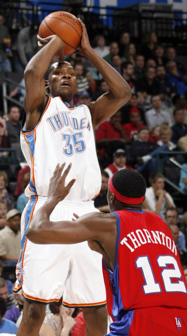 Kevin Durant of the Thunder shoots over Al Thornton of the Clippers in the first half of the NBA basketball game between the Oklahoma City Thunder and the Los Angeles Clippers at the Ford Center in Oklahoma City, Wednesday, Nov. 19, 2008. BY NATE BILLINGS, THE OKLAHOMAN