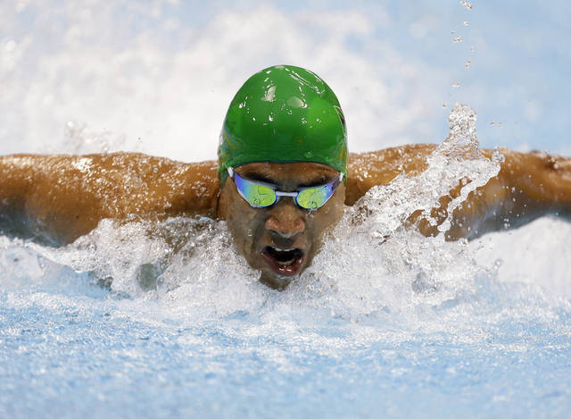 Achmat Hassiem of South Africa swims in the men's 100 meter butterfly S10 race at the 2012 Paralympics games, Saturday, Sept. 1, 2012, in London. (AP Photo/Alastair Grant)