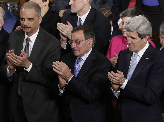 From left, Attorney General Eric Holder, outgoing Defense Secretary Leon Panetta and Secretary of State John Kerry applaud  during President Barack Obama's State of the Union address during a joint session of Congress on Capitol Hill in Washington, Tuesday Feb. 12, 2013. (AP Photo/J. Scott Applewhite) ORG XMIT: CAP115