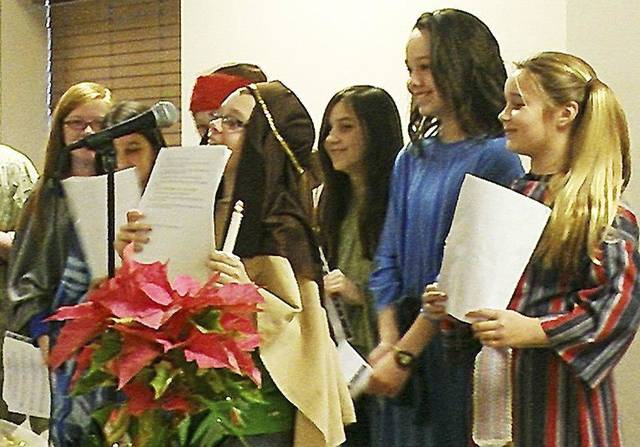 Fifth-grade students at St. Mary's Episcopal School recite the story of Jesus' birth from the Bible in Spanish during the recent Las Posadas event at the Edmond school. Photo provided   <strong></strong>