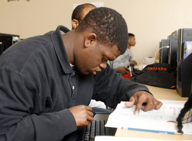 Tracy Chrinedu works on studies Thursday at Douglass High School in Oklahoma City.