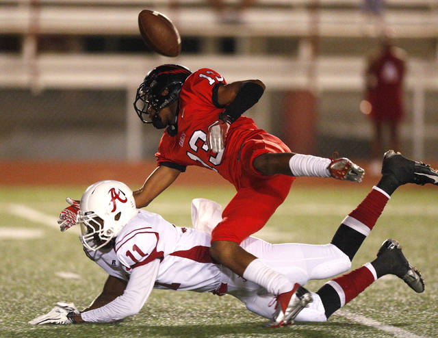 Del City's Shawn Epps, at right, breaks up a pass intended for Ardmore's Devin Reynolds during a high school football game in Del City, Okla., Friday, September 28, 2012. Photo by Bryan Terry, The Oklahoman