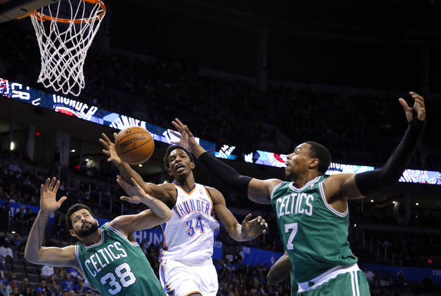 Oklahoma City's Hasheem Thabeet (34) fights Boston's Vitor Faverani (38) and Jared Sullinger (7) for a rebound during the NBA game between the Oklahoma City Thunder and the Boston Celtics at the Chesapeake Energy Arena., Sunday, Jan. 5, 2014. Photo by Sarah Phipps, The Oklahoman