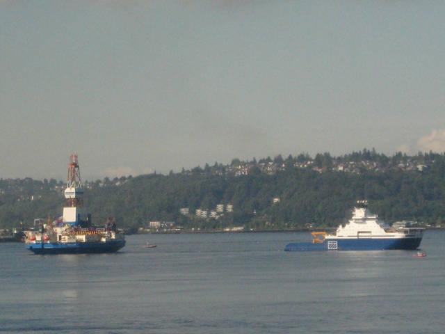 Ships bringing oil drilling equipment to Alaska pass through Seattle's Elliott Bay on Wednesday, June 27, 2012. The Kulluk and Noble Discoverer and support ships are headed first to Dutch Harbor. Once open water allows, the rigs will move to the Beaufort and Chukchi seas for offshore drilling. (AP Photo/Donna Gordon Blankinship)