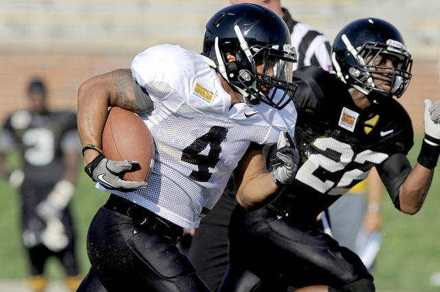 University of Missouri's tailback Kendial Lawrence scores a touchdown during a scrimmage at NCAA college football practice, Thursday, Aug. 18, 2011, in Columbia, Mo. (AP Photo/Columbia Daily Tribune, Parker Eshelman) ORG XMIT: MOCOD107