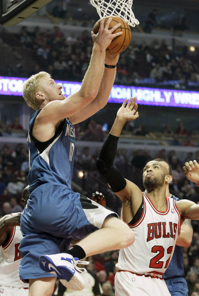 Minnesota Timberwolves forward Chase Budinger (10), left, goes up for a shot as Chicago Bulls forward Taj Gibson (22) watches during the first half of an NBA basketball game in Chicago on Saturday, Nov. 10, 2012. (AP Photo/Nam Y. Huh)