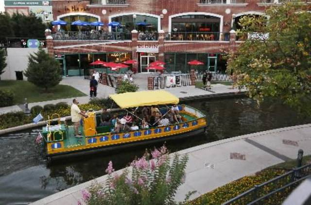 A canal boat travels through Bricktown in Oklahoma City, Friday, Aug. 2, 2013. Photo by Nate Billings, The Oklahoman