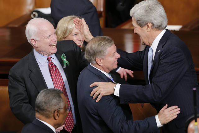 Secretary of State John Kerry, right, greets Sen.Lindsey Graham, R-S.C., center, and Sen. John McCain, R-Ariz, before President Barack Obama's State of the Union address during a joint session of Congress on Capitol Hill in Washington, Tuesday Feb. 12, 2013. (AP Photo/J. Scott Applewhite) ORG XMIT: CAP111