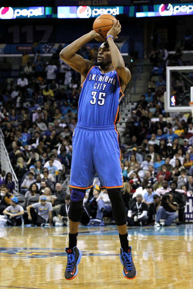 Oklahoma City's Kevin Durant (35) shoots the ball during the second half of an NBA basketball game against the New Orleans Hornets in New Orleans, Friday, Nov. 16, 2012. The Thunder won 110-95. (AP Photo/Jonathan Bachman) ORG XMIT: LAJB110