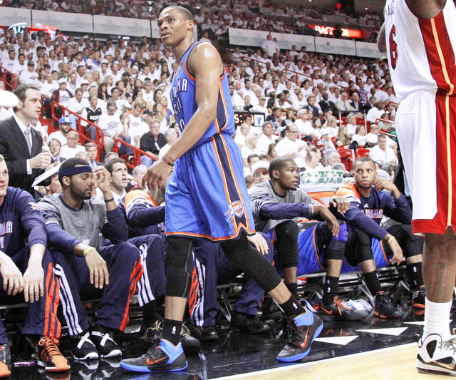 Oklahoma City's Russell Westbrook, center, was not happy when Scott Brooks put him on the bench in the third quarter of Game 3. Photo by Bryan Terry, The Oklahoman