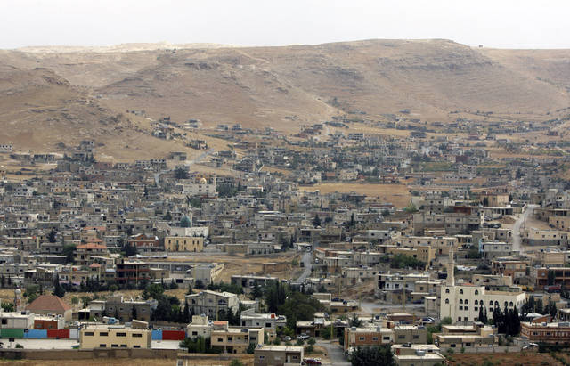 In this Tuesday, Oct. 2, 2012 photo, a general view of Arsal, a Sunni Muslim town eastern Lebanon near the Syrian border, has become a safe haven for war-weary Syrian rebels and hundreds of refugee families. Many in Arsal support the rebels, but the town�s stand is risking heightened tensions with its Shiite Muslim neighbors in an area controlled by Hezbollah, a militia that backs the Syrian regime. Deepening sectarian rifts are one of the ways in which Syria�s 18-month-old conflict is destabilizing an already volatile region. (AP Photo/Bilal Hussein)