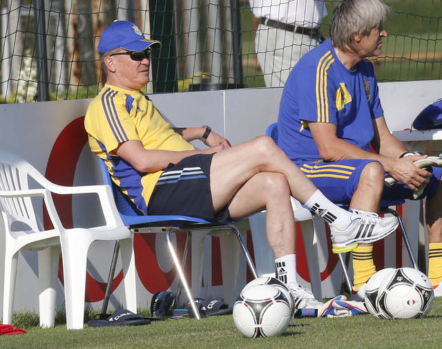 Ukraine head coach Oleg Blokhin watches the training of his team on the eve of the Euro 2012 soccer championship Group D match between Ukraine and England in Donetsk, Ukraine, Monday, June 18, 2012. (AP Photo/Efrem Lukatsky)