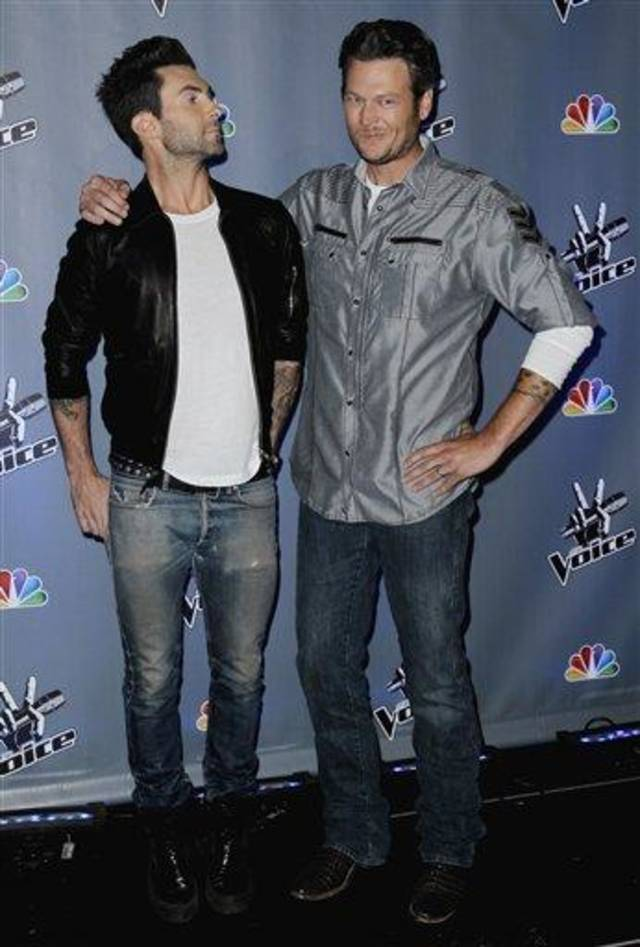 """Musicians Adam Levine, left, and Blake Shelton, from the reality television competition """"The Voice"""", pose for photographers in Culver City, Calif., Friday, Oct. 28, 2011.  Season two of """"The Voice"""" will premiere Feb. 5 on NBC. (AP Photo/Matt Sayles)"""
