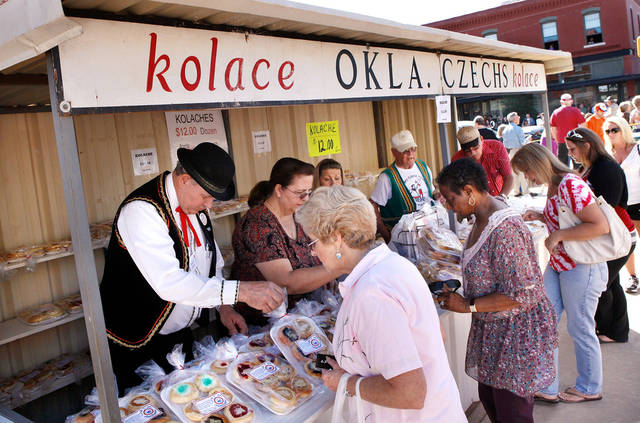 Customers shop for kolaches at the booth sponsored by Oklahoma Czechs, Inc. Pleasant temperatures and a deep blue sky  provided a perfect setting for Yukon's 46th annual Oklahoma Czech Festival  Saturday, Oct. 1, 2011.  Thousands of visitors crammed downtown streets to watch the morning parade, eat authentic Czech foods,listen and dance to  music played by polka bands, and buy  fruit-filled kolaches by the dozens. Photo by Jim Beckel, The Oklahoman