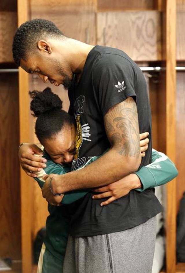 Oklahoma City Thunder's Perry Jones III consoles Baylor's Odyssey Sims (0) in the locker room following the college basketball game between Baylor University and the Louisville at the Oklahoma City Regional for the NCAA women's college basketball tournament at Chesapeake Energy Arena in Oklahoma City, Sunday, March 31, 2013. Photo by Sarah Phipps, The Oklahoman