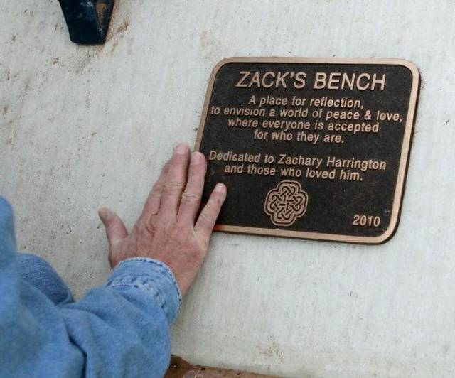 Van Harrington wipes dirt off of a plaque that his family wrote for Van's son Zack Harrington, who committed suicide last year. The plaque sits at Zack's Bench, in a neighborhood park Norman on Wednesday, Oct. 26, 2011. Photo by John Clanton, The Oklahoman ORG XMIT: KOD