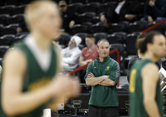 North Dakota head basketball coach Saul Phillips watches practice for the NCAA men's basketball tournament at the Spokane Arena in Spokane, Wash., Wednesday, March 19, 2014.Photo by Sarah Phipps, The Oklahoman