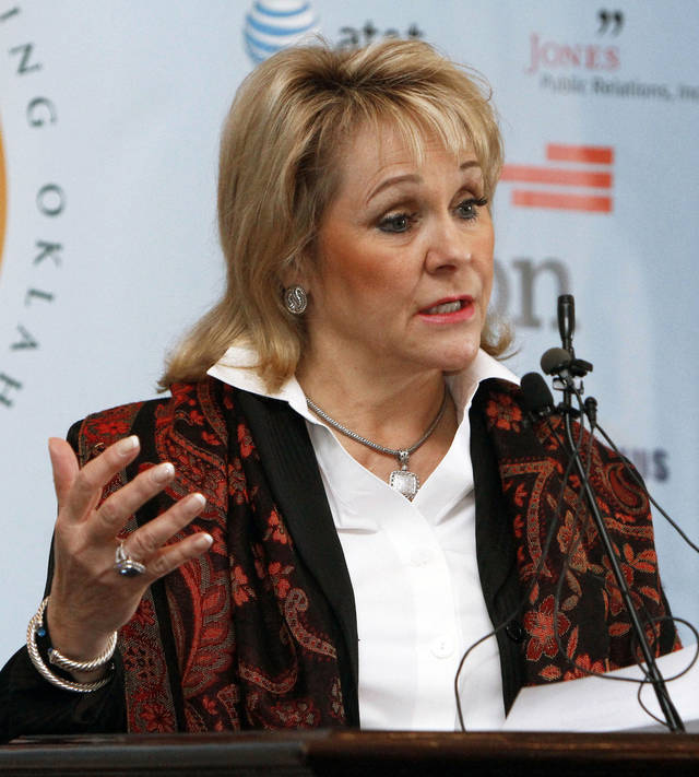 Gov. Mary Fallin announces Monday during a news conference that Oklahoma won�t set up a health care exchange.  Photo By Paul Hellstern,  The Oklahoman