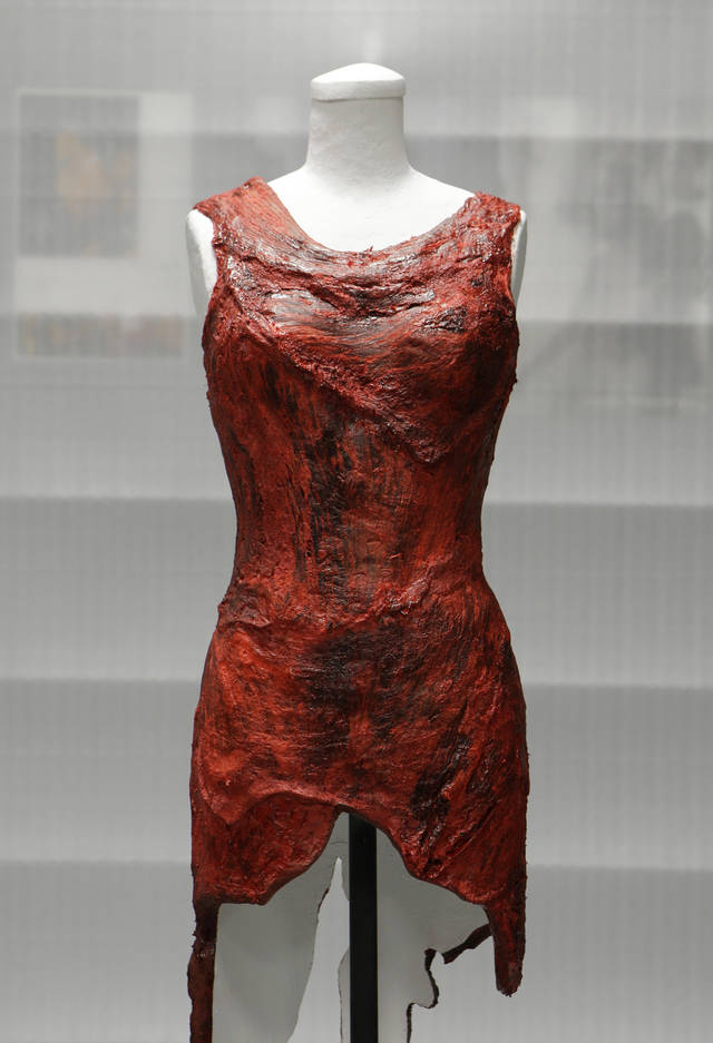 FILE - In this file photo taken June 14, 2011, the dress made of meat worn by Lady Gaga at the 2010 MTV Video Music Awards is shown in the museum's vault. A former Ketchikan, Alaska man now has own place in pop history. Sergio Vigalato is the taxidermist who preserved Lady Gaga's now-famous raw-meat dress. The dress is now on display at the Rock and Roll Hall of Fame and Museum in Cleveland. (AP Photo/Mark Duncan, File)