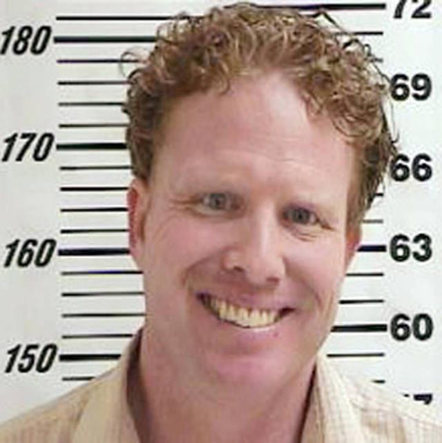 FILE -This undated file photo provided by the Davis County Jail, shows Jeremy Johnson, a Utah businessman accused of running a $350 million fraud scheme through his company is planning changing his plea Friday Jan. 11, 2013. Federal prosecutors have charged Johnson with one count of mail fraud in U.S. District Court in Salt Lake City, and if convicted he faces up to 20 years in prison. (AP Photo/ Davis County Jail, File)