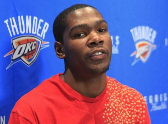 Oklahoma City Thunder's  Kevin  Durant is pictured at the team's final media session before breaking for the offseason, Thursday, April 16, 2009, in Oklahoma City.  Durant said he will be returning to school during the summer. (AP Photo/Sue Ogrocki)