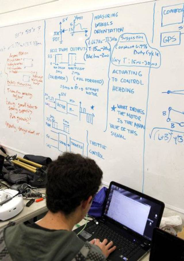 A whiteboard is covered in diagrams and instructions, as students from middle and high schools compete with flying drones at the University of Oklahoma&#039;s Rawls Engeineering Practice Facility in Norman, OK, Saturday, Dec. 3, 2011. By Paul Hellstern, The Oklahoman ORG XMIT: KOD