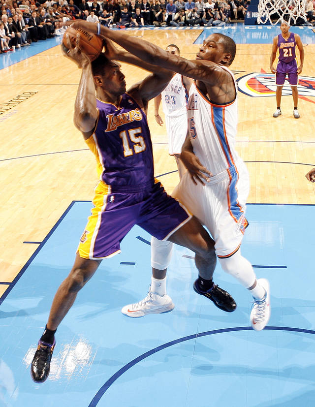 Oklahoma City's Kevin Durant (35) defends Los Angeles' Metta World Peace (15) during an NBA basketball game between the Oklahoma City Thunder and the Los Angeles Lakers at Chesapeake Energy Arena in Oklahoma City, Friday, Dec. 7, 2012. Oklahoma City won, 114-108. Photo by Nate Billings, The Oklahoman