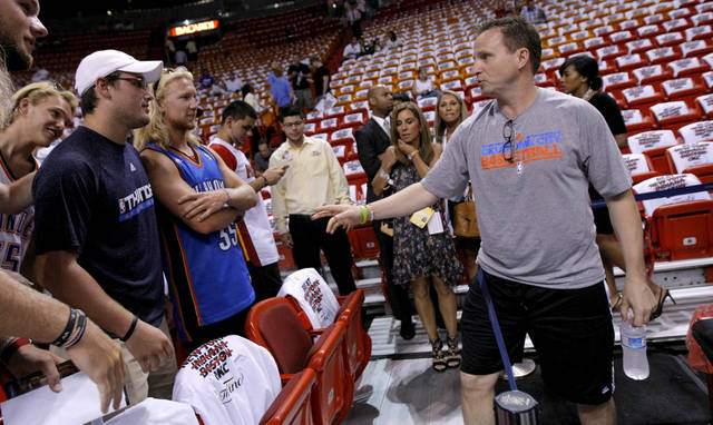 Oklahoma CIty coach Scott Brooks greets fans before Game 3 of the NBA Finals between the Oklahoma City Thunder and the Miami Heat at American Airlines Arena, Sunday, June 17, 2012. Photo by Bryan Terry, The Oklahoman