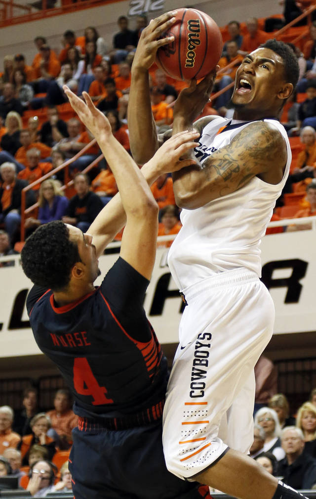 Texas Tech's Ty Nurse (4) fouls Oklahoma State's Le'Bryan Nash (2) during a men's college basketball game between Oklahoma State University and Texas Tech at Gallagher-Iba Arena in Stillwater, Okla., Saturday, Jan. 19, 2013. OSU won, 79-45. Photo by Nate Billings, The Oklahoman